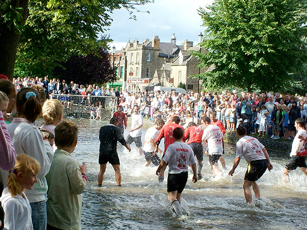 Bourton on the Water - Football in the river Windrush